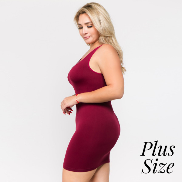 "Solid seamless plus size tank slip dress. Approximately 28"" in length.  • Sleeveless  • Scoop neckline  • Fits like a glove  • Soft and stretchy  • Seamless design for comfort  • Short length hem  • Imported  - One size fits most plus 16-22  - Composition: 92% Nylon, 8% Spandex"