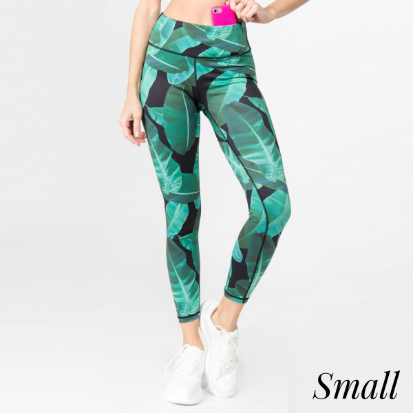 """Palm leaf printed athletic leggings. Inseam approximately 28"""" in length.   • Flat reinforced high rise waistband  • Hidden waistband pocket for keys, phone, cash  • Palm leaf print  • Flat stitched seams prevent chafing  • Triangle crotch gusset eliminates camel toe  • 4 way stretch fabric for a move with you feel  • Moisture wick  • Perfect for the gym, yoga, travel, lounging  • Full length  • Imported   - Size: Small  - Composition: 46% Polyester, 41% Nylon, 13% Spandex"""