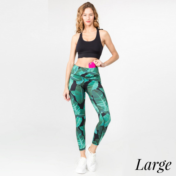"""Palm leaf printed athletic leggings. Inseam approximately 28"""" in length.   • Flat reinforced high rise waistband  • Hidden waistband pocket for keys, phone, cash  • Palm leaf print  • Flat stitched seams prevent chafing  • Triangle crotch gusset eliminates camel toe  • 4 way stretch fabric for a move with you feel  • Moisture wick  • Perfect for the gym, yoga, travel, lounging  • Full length  • Imported   - Size: Large  - Composition: 46% Polyester, 41% Nylon, 13% Spandex"""