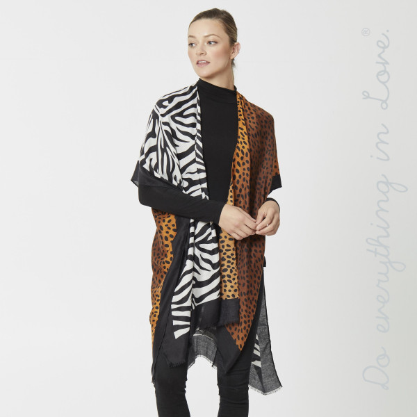 "Do everything in Love brand lightweight animal print kimono.  - One size fits most 0-14 - Approximately 36"" in length - 100% Polyester"