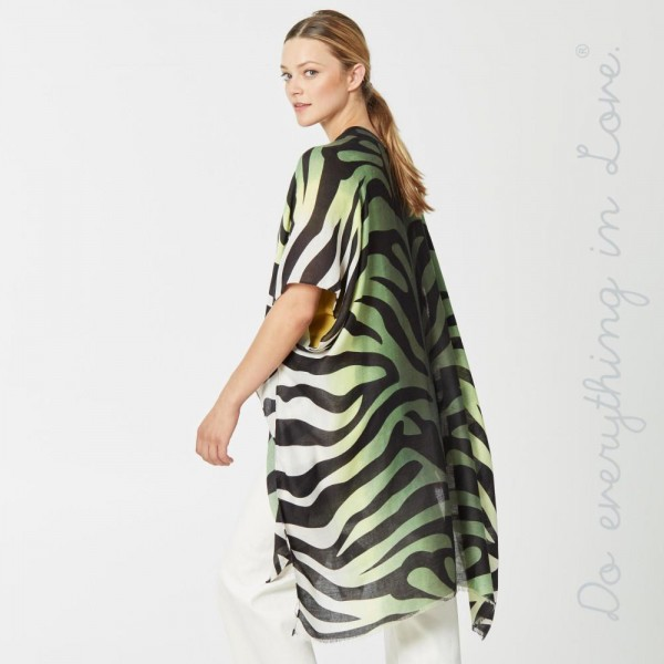 """Do everything in Love brand lightweight ombre zebra print kimono.  - One size fits most 0-14 - Approximately 36"""" in length - 100% Polyester"""