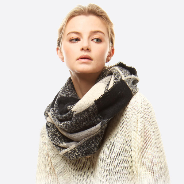 "Soft touch plaid boucle infinity scarf.  - Approximately 23"" W x 66"" L - 100% Polyester"