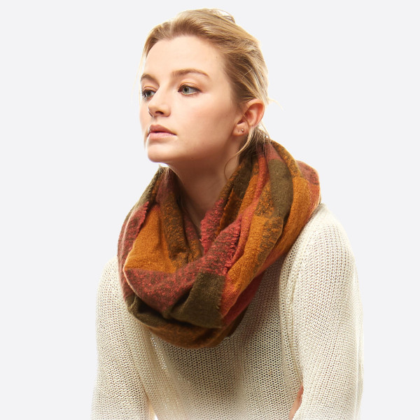 """Soft touch plaid boucle infinity scarf.  - Approximately 23"""" W x 66"""" L - 100% Polyester"""