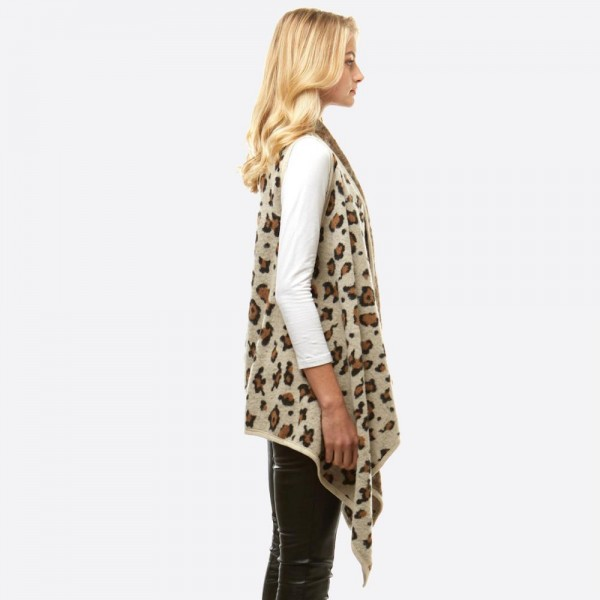 """Leopard print vest.  - One size fits most 0-14 - Approximately 35"""" in length - 100% Acrylic"""