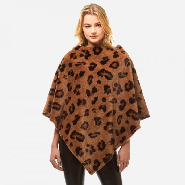 """Faux fur leopard print poncho.  - One size fits most 0-14 - Approximately 32"""" in length - 100% Polyester"""