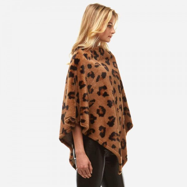 "Faux fur leopard print poncho.  - One size fits most 0-14 - Approximately 32"" in length - 100% Polyester"