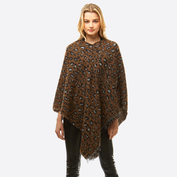 """Soft touch leopard print metallic confetti string poncho with frayed edges. The metallic thread gives this poncho a glimmering, glittering look with a slight rainbow sheen.   - One size fits most 0-14 - Approximately 36"""" in length - 100% Polyester"""