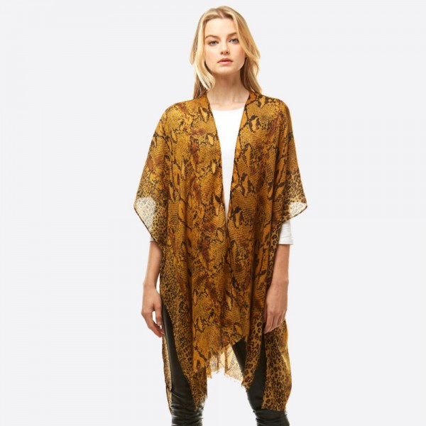 "Lightweight multi animal print kimono.  - One size fits most 0-14 - Approximately 36"" in length - 100% Polyester"