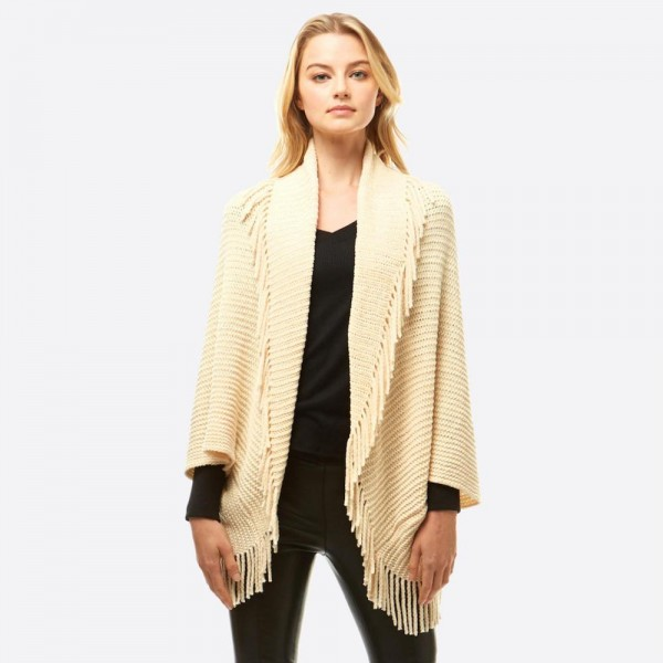 "Solid color chenille shrug/shawl with fringes.  - One size fits most 0-14 - Approximately 36"" in length - 100% Polyester"