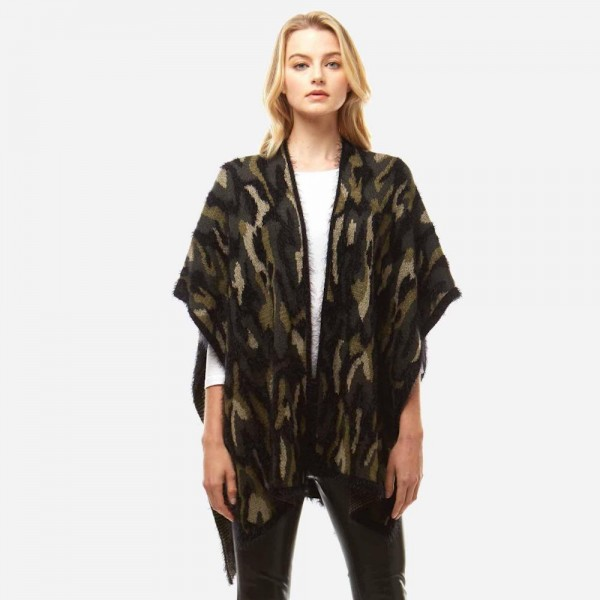 """Fuzzy camo vest with sleeves.  - One size fits most 0-14 - Approximately 35"""" in length - 50% Nylon, 50% Acrylic"""