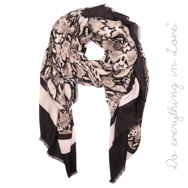 """Do everything in Love brand lightweight bordered snakeskin printed scarf.  - Approximately 34"""" W x 72"""" L  - 100% Polyester"""