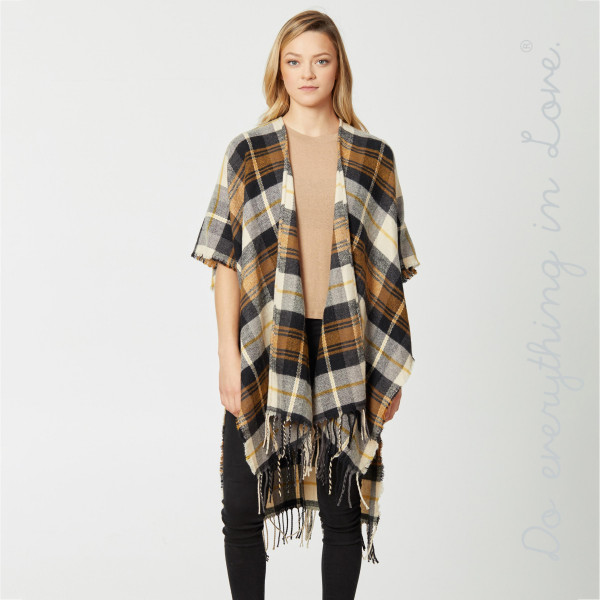 "Do everything in Love brand plaid print kimono with fringes.  - One size fits most 0-14 - Approximately 39.5"" L - 65% Acrylic, 35% Polyester"
