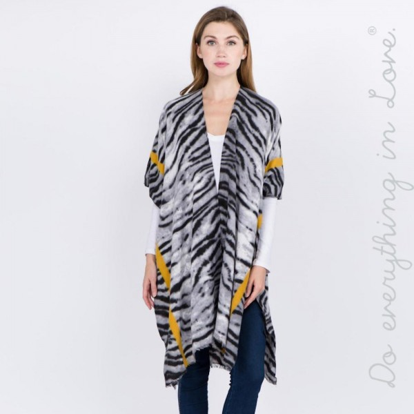"""Do everything in Love brand soft touch bordered stipe tiger print kimono.  - One size fits most 0-14 - Approximately 37"""" L - 100% Viscose"""