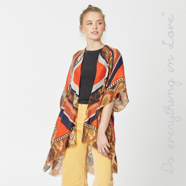 """Do everything in Love brand lightweight designer inspired kimono.  - One size fits most 0-14 - Approximately 36"""" in length - 100% Viscose"""