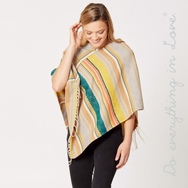 """Do everything in Love brand ethnic stripe poncho with fringes.  - One size fits most 0-14 - Approximately 34"""" L - 65% Acrylic, 35% Polyester"""