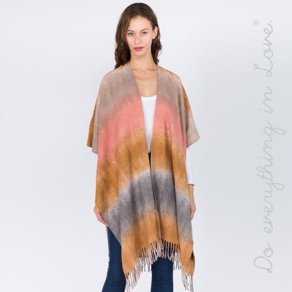 """Do everything in Love brand tie dye kimono with fringes.  - One size fits most 0-14 - Approximately 37"""" L - 70% Polyester, 30% Viscose"""