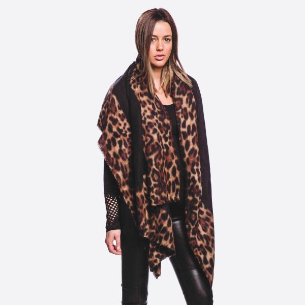 "Soft touch leopard print border vest.  - Approximately 34"" in length, longest length 47"" L - 20% Cotton, 80% Polyester"
