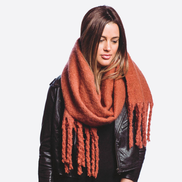 """Solid color soft touch oblong scarf with fringes.  - Approximately 17"""" W x 84"""" L - 100% Polyester"""