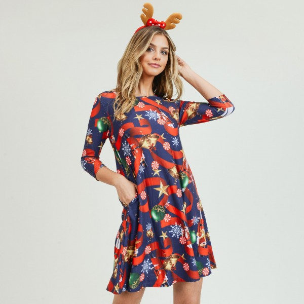 """Women's Christmas nutcracker print A-Line dress with pocket details.   • 3/4 length sleeves • Crew neck • Two side seam pockets to keep your hands warm • A-line silhouette • Nutcracker Christmas print • Soft and comfortable fabric with stretch • Perfect for styling with heels or booties • Imported  - Pack Breakdown: 6pcs / pack - Sizes: 2S / 2M / 2L - Approximately 34"""" L - 95% Polyester, 5% Spandex"""