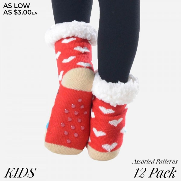 Kids assorted Christmas character faux sherpa lined slipper socks.  • Variety of holiday characters  • Reinforced toe seam  • Silicon rubber dot traction bottom  • Plush faux sherpa lining  • Thick  • Breathable  • Perfect for wearing indoors  • Imported   - Pack Breakdown: 12pcs / pack - Sizes: 6 S/M / 6 M/L - Composition: 40% Acrylic, 60% Polyester
