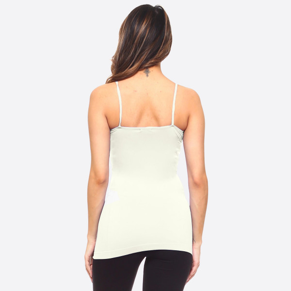 "Women's solid seamless camisole tank top.  • Spaghetti straps  • Seamless design for extra comfort  • Longline hem  • Soft and stretchy  • Fits like a glove  • Perfect for layering under sheer tops or by itself  • Imported   - One size fits most 0-14 - Approximately 18"" L - 92% Nylon, 8% Spandex"