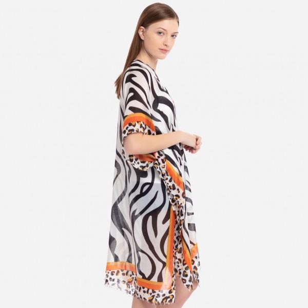 "Lightweight leopard print bordered zebra print kimono.  - One size fits most 0-14 - Approximately 37"" L - 100% Polyester"