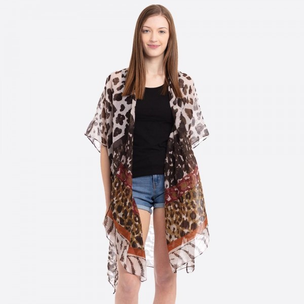 "Lightweight mixed animal print kimono.  - One size fits most 0-14 - Approximately 37"" L - 100% Polyester"