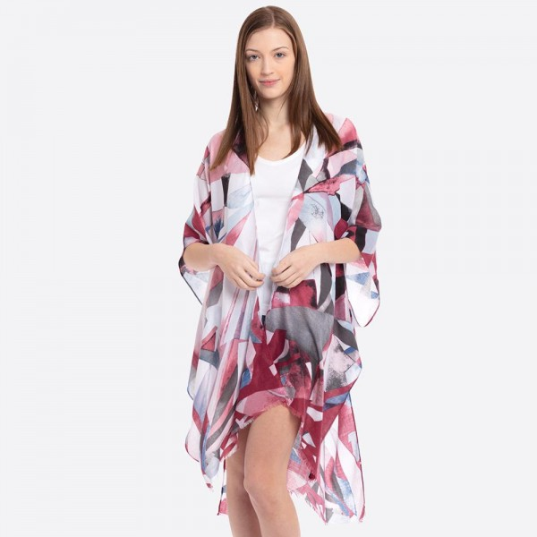 "Mosaic print kimono.  - One size fits most 0-14 - Approximately 37"" in length - 60% Cotton, 40% Polyester"