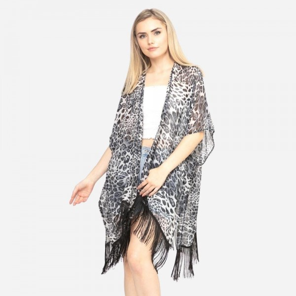 "Leopard print fringe tassel kimono.  - One size fits most 0-14 - Approximately 37"" L - 100% Polyester"