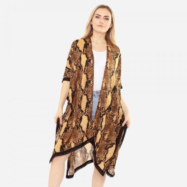 "Women's soft lightweight snakeskin kimono.  - One size fits most 0-14 - Approximately 37"" L - 100% Polyester"