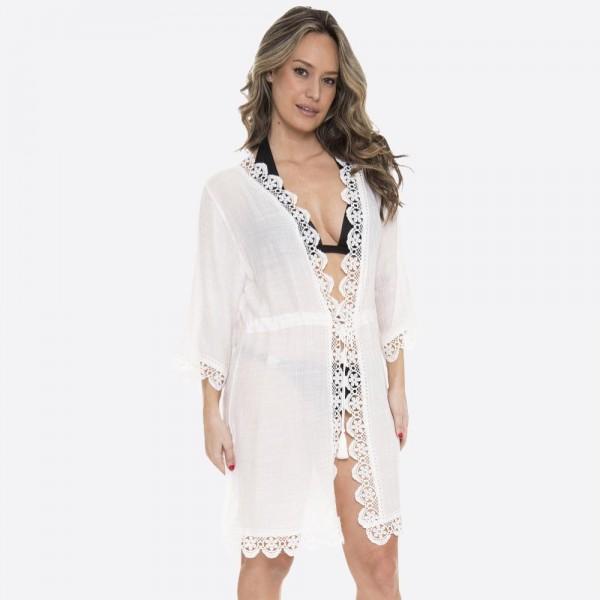 "Women's lightweight floral crochet trim kimono.  - Front tie tassel closure - One size fits most 0-14 - Approximately 37"" L - 100% Viscose"