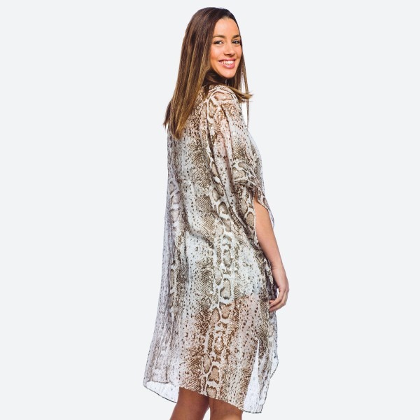 """Women's lightweight sheer snakeskin kimono with silver metallic accents.  - One size fits most 0-14 - Approximately 37"""" L  - 100% Polyester"""
