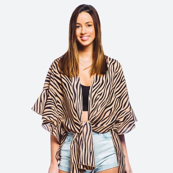 "Women's lightweight zebra print ruffle kimono.  - One size fits most 0-14 - Approximately 33"" L - 100% Polyester"