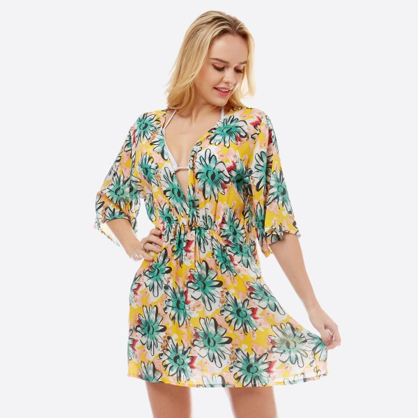 """Women's lightweight low cut v-neck and back flower top with back tie closure.  - Elastic waistband detail  - Low cut v-neck and back - Back tie closure - V neck approximately 17"""" L - Approximately 30"""" L overall  - 100% Polyester"""