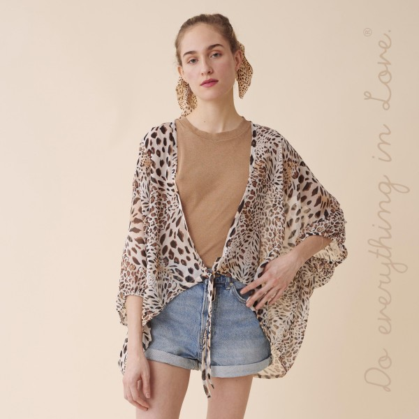 """Do everything in Love brand women's lightweight sheer leopard print crop kimono with front tie detail.  - Front tie closure - One size fits most 0-14 - Approximately 25"""" L - 100% Polyester"""