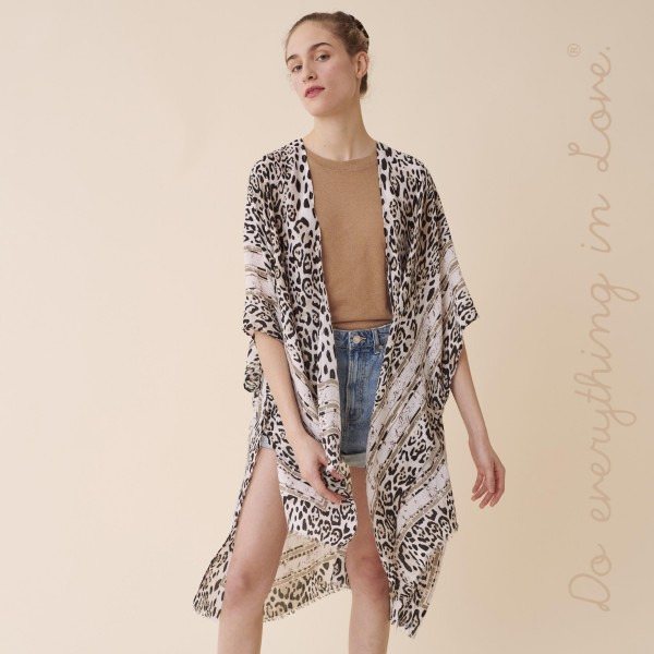 """Do everything in Love brand women's lightweight leopard print stipe kimono.  - One size fits most 0-14 - Approximately 37"""" L - 100% Polyester"""