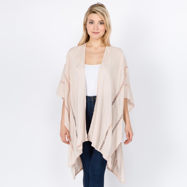 """Women's lightweight solid kimono with crochet trim.  - One size fits most 0-14 - Approximately 32"""" L - 100% Viscose"""