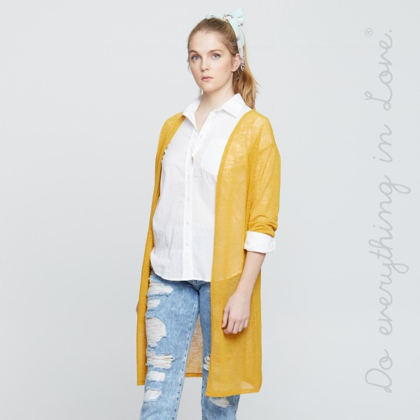 """Do everything in Love brand women's lightweight solid long sleeve kimono.  - One size fits most 0-14 - Approximately 37"""" L - 100% Polyester"""