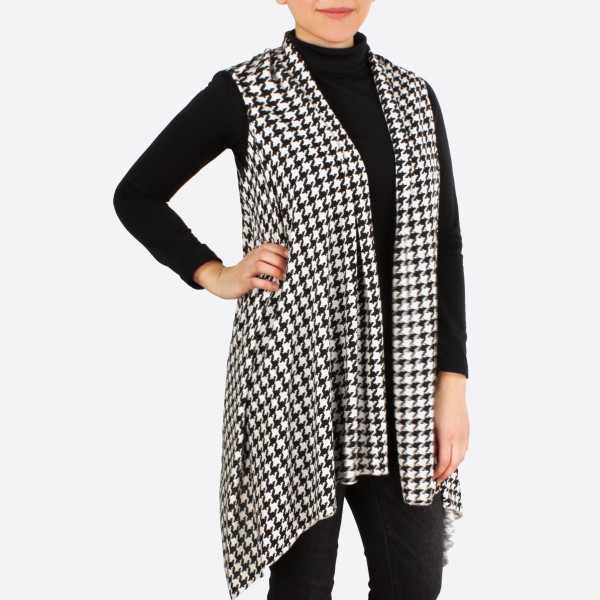 Black and white houndstooth vest. 100% Polyester. One size fits most.