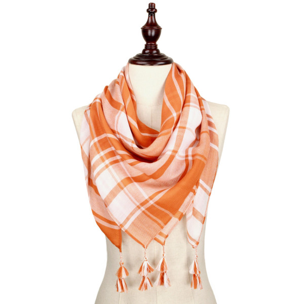 Orange and white lightweight plaid scarf with tassels. 100% polyester.
