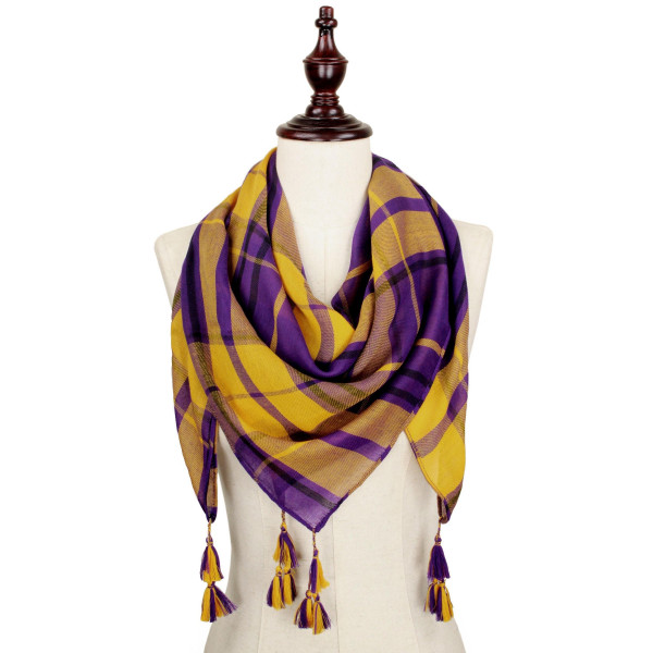 Purple and gold lightweight plaid scarf with tassels. 100% polyester.