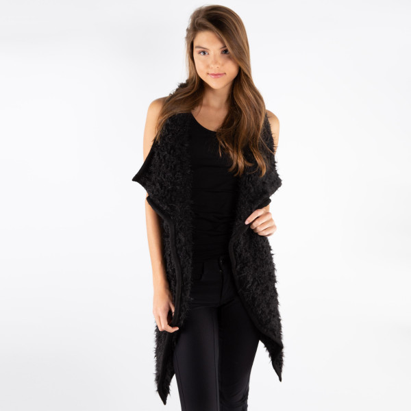 Black faux fur vest with faux front pockets and a tapered front. 100% polyester. One size fits most.