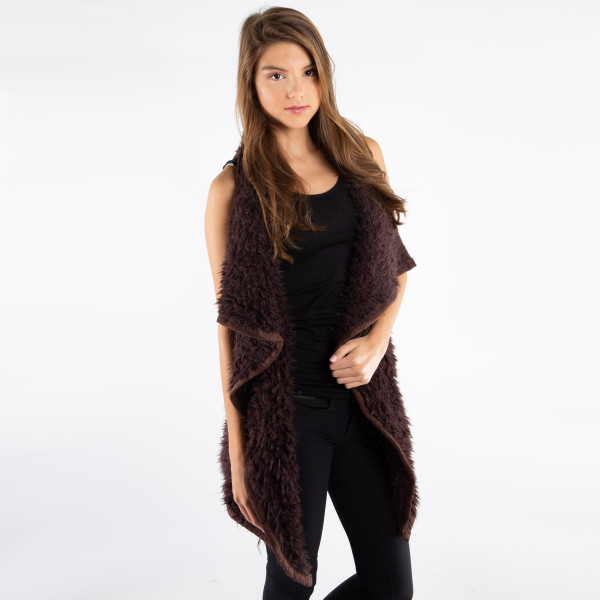 Dark brown faux fur vest with faux front pockets and a tapered front. 100% polyester. One size fits most.