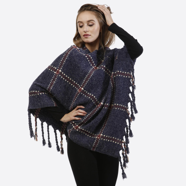Navy blue poncho with a plaid design and tassel accents. 100% acrylic. One size fits most.