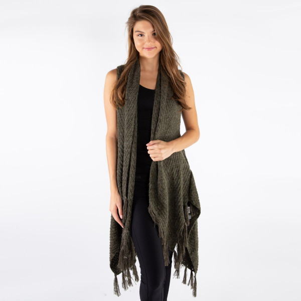 Olive green knit vest with a tapered front and fringe along the bottom hem. 100% acrylic. One size fits most.