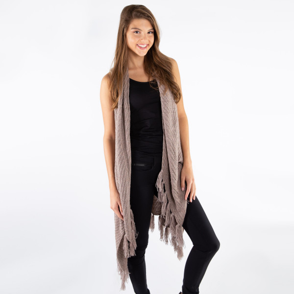 Taupe vest with a tapered front collar and tassels along the bottom hem. 100% acrylic. One size fits most.