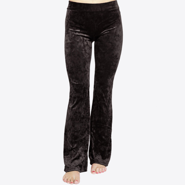 Crushed Velvet Flare Pants featuring a hip-hugging fit, pull-up front closure, and flared legs. 