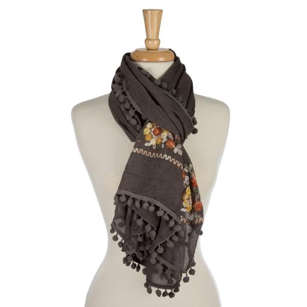 "Lightweight, open scarf with an embroidered, floral print and a pom pom trim. 65% polyester and 35% viscose. Measures 76"" x 28"" in size."