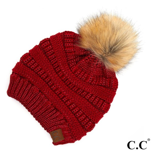 Metallic thread, cable knit, original C.C beanie with a faux fur pom pom, in red. 100% acrylic.