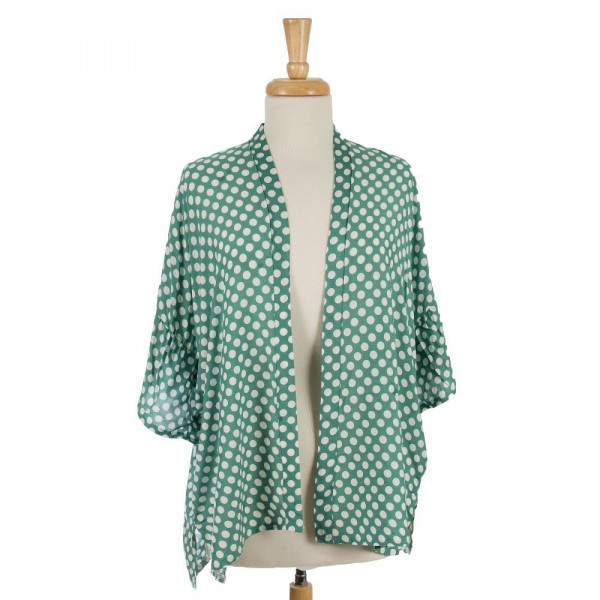 Lightweight, short sleeve kimono with a polkadot print and ruffled sleeves. 100% viscose. One size fits most.